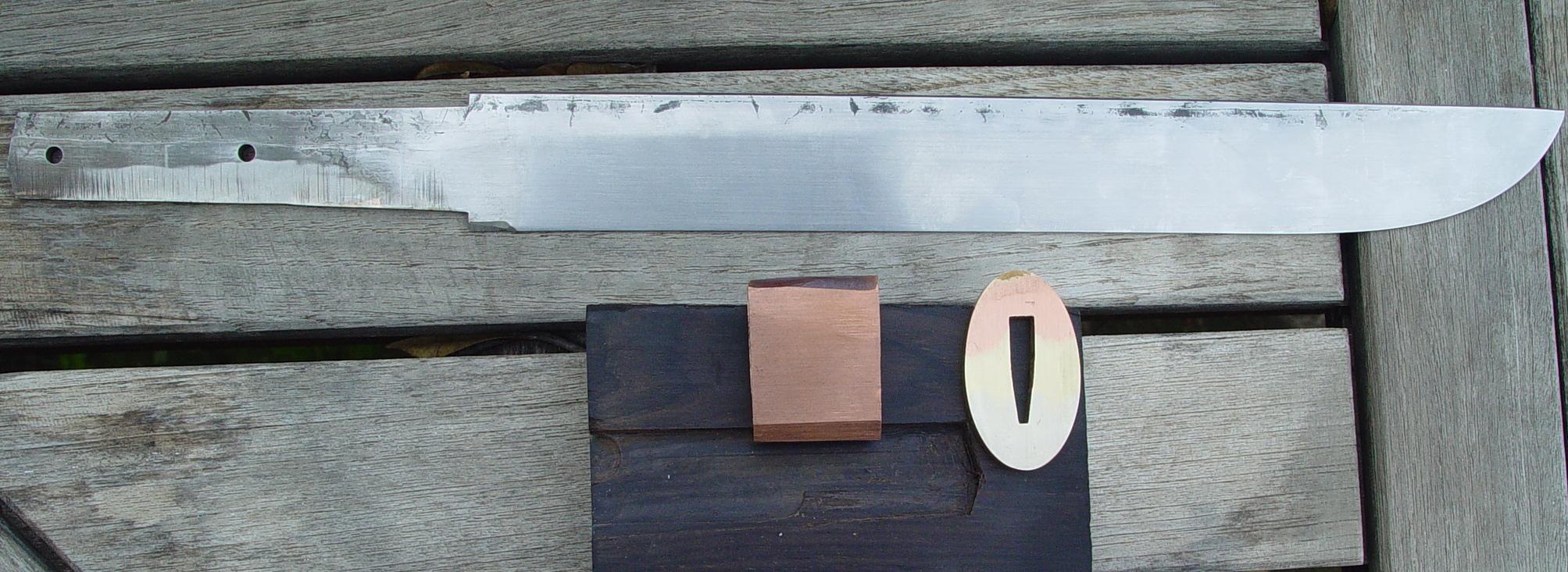 Mokume Tsuba and Copper Habaki. Blade is Vinland patern by Damasteel