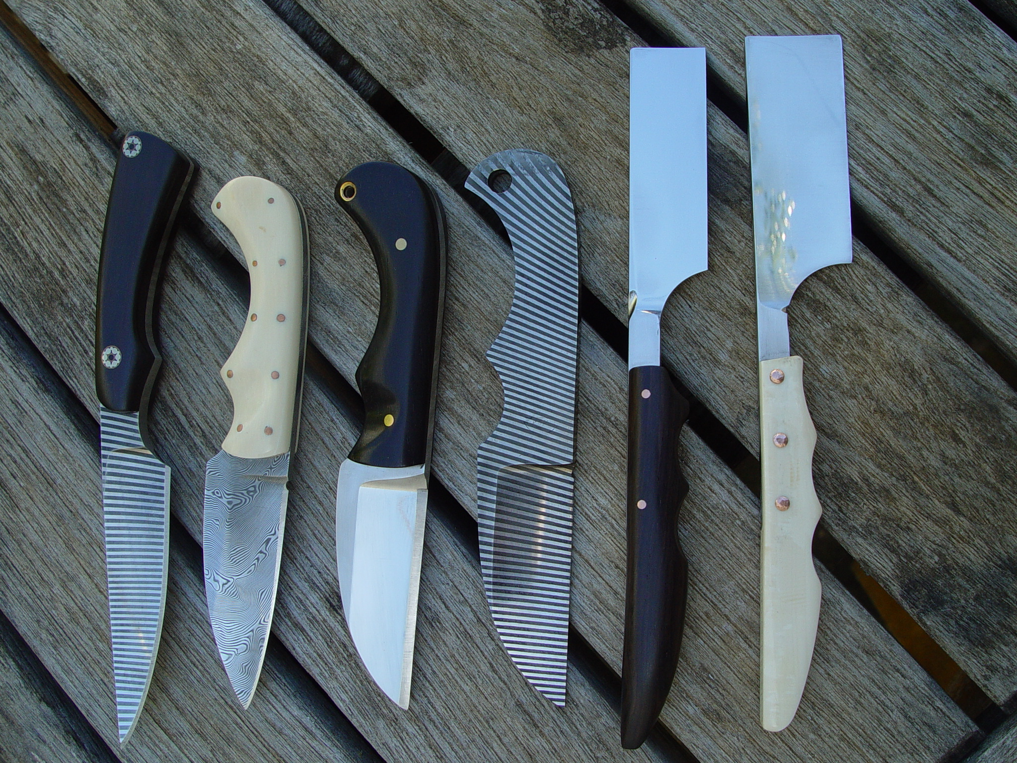 Selection of small blades Three Biltong blades two razors and a Bird & Trout